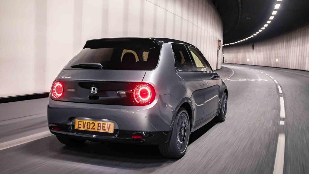 Honda e 2020 rear quarter driving in tunnel